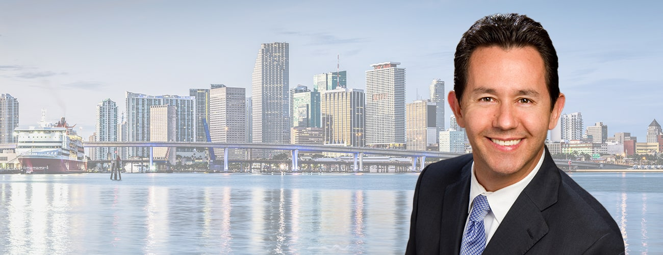 Hero Banner - Picture of Patrick Vilar over a skyline of Miami.